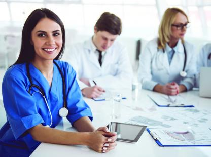 Photo of doctor at a conference table