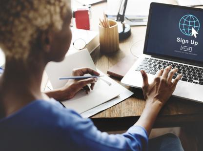 photo of a woman on a laptop